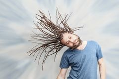 Braided Hair Young Man Tossing His Hair. Elegantly moving, hinting he is dreaming or falling in abstract background Stock Image