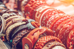 Braided handmade leather bracelets in sunlight. Toned royalty free stock image