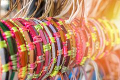 Braided handmade leather bracelets in sunlight,. Toned royalty free stock images