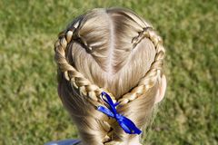 Braided Heart. Young girl shows off her hair braided into a heart shape stock photography