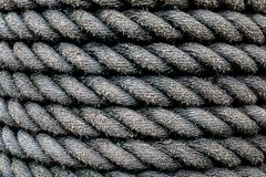 Braided industrial rope background. It is wet due to the rain. royalty free stock photos