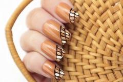 Braided manicure. Royalty Free Stock Photo