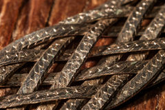 Braided metal strips with scales Royalty Free Stock Photography