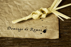 Braided palm and text Domingo de Ramos, Palm Sunday in spanish Stock Photos