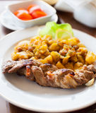 Braided pork tenderloin with garnish Stock Photography