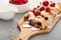 Braided raspberry danish with glaze Stock Photography