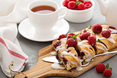 Braided raspberry danish with glaze Stock Photo
