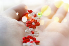 Braided red and white string bracelet Royalty Free Stock Photos