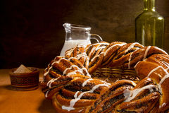 Braided roll with poppy seeds and cinnamon Stock Photo