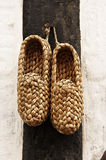 Braided shoes. Hanging on wall as decoration Stock Photography