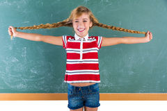 Braided student blond girl playing with braids Royalty Free Stock Photography