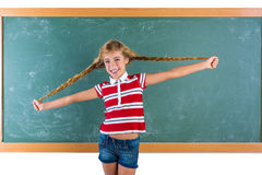 Braided student blond girl playing with braids Stock Photography