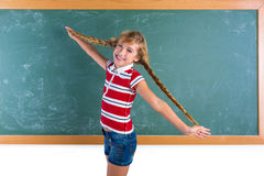 Braided student blond girl playing with braids Royalty Free Stock Photo