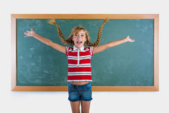 Braided student blond girl playing with braids Royalty Free Stock Photos