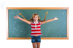 Braided student blond girl playing with braids Stock Photo