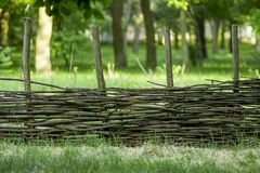 Braided Cossack village fence. Russian fence. stock photo