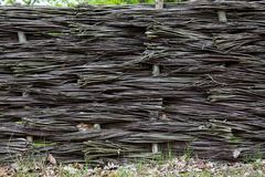Braided wicker fence in the countryside Stock Photos