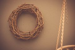 Braided wreath on the wall, scandinavian style home decoration stock photo