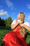 Braiding braids ... Russian beauty in the meadow plait braid Royalty Free Stock Photography