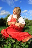 Braiding braids ... Russian beauty in the meadow plait braid Royalty Free Stock Image