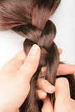Braiding hair. Brown,close up Stock Photo
