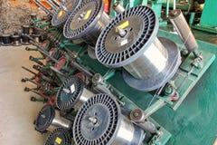 Braiding machine.Steel wire spools. Stock Photo