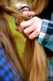 Braiding my sisters hair Stock Photos