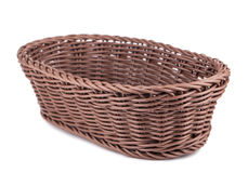 Braiding small basket. Braiding small wicker basket on white background Royalty Free Stock Photo