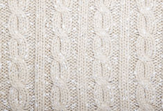 Braids pattern knit beige color  . Royalty Free Stock Photos