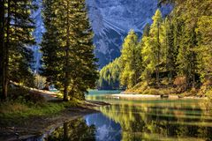 Braies Lake, Dolomites, Trentino Alto Adige, Italy. Hike road along Braies Lake, Dolomites, Trentino Alto Adige, Italy in Autumn day stock image