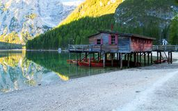Braies lake and house in the background of Seekofel mountain P. Braies lake and house in the background of Seekofel mountain in Dolomites,Italy Pragser Wildsee royalty free stock image