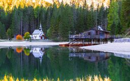 Braies lake and house in the background of Seekofel mountain. In Dolomites,Italy Pragser Wildsee royalty free stock photo