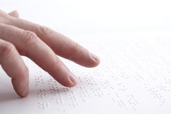 Braille. Person reading braille in swedish Stock Photo