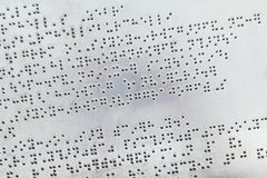 Braille alphabet on metal plate. Background Stock Image