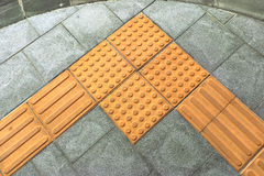 Braille block tactile paving for blind handicap Stock Images