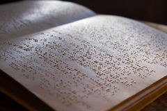 Braille book. Page written in braille alphabet for blind people Stock Photography