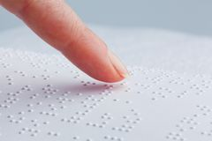 Braille and finger. Book in Braille Stock Photography