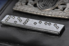 Braille strip on a police warrant card Stock Photography