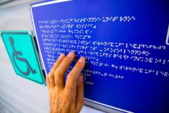 Braille text touching the relief stock photo