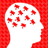 Brain as Puzzle Pieces In Head. An illustration featuring a human head silhouette in white with red puzzle piece inside to represent mysteries of the mind Stock Photography