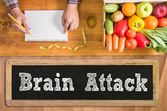 Brain Attack. Fresh vegetables and on a wooden table royalty free stock photos