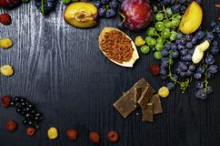 Brain boosting health food background border with fruits, nuts,berry. Foods high in vitamin C, vitamins, minerals, antioxidants an royalty free stock images