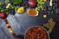 Brain boosting health food background border with fruits, nuts,berry. Foods high in vitamin C, vitamins, minerals, antioxidants an stock photos