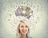 Brain. Close up portrait of a young woman with colorful gear brain above head. Happy emotion, positive thinking with arrows and curves as thoughts. Concept for royalty free stock photography