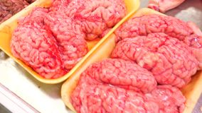 Brain of a cow over in the showcase of the meat market, bazaar. 4k, stock footage