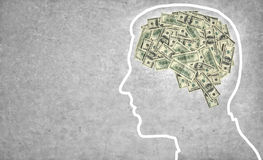 Brain currency. Outline of a man's head with the brain in the shape of money Stock Image