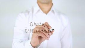 Brain Development, escrita do homem em vidro, escrito à mão Foto de Stock