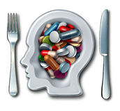 Brain Drugs. And neuroscience medicine concept as a dinner plate with knife and fork shaped as a human head with medication as pills and capsules as a smart Stock Images