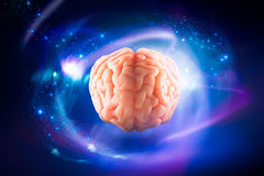 Brain floating on  a blue background / thoughts concept Stock Photography