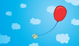 Brain floating tied to a balloon Royalty Free Stock Image